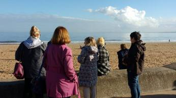 the-writing-workshop-participants-visit-the-beach-for-inspiration
